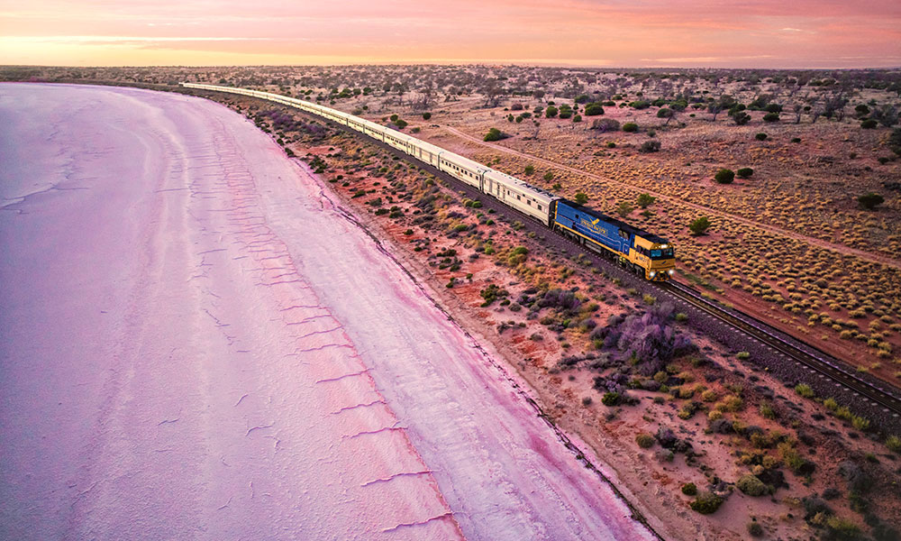 The Indian Pacific passing by Lake Heart. Credit: Journey Beyond