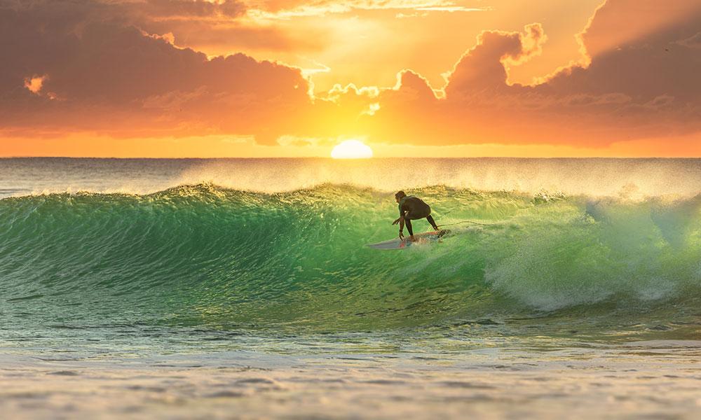 Surfing at Sandon Point